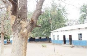 The schoolyard with the Zambian flag